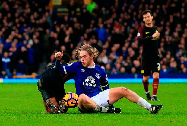 Manchester City's Raheem Sterling (left) tangles with Everton's Tom Davies. Photo credit: Peter Byrne/PA Wire