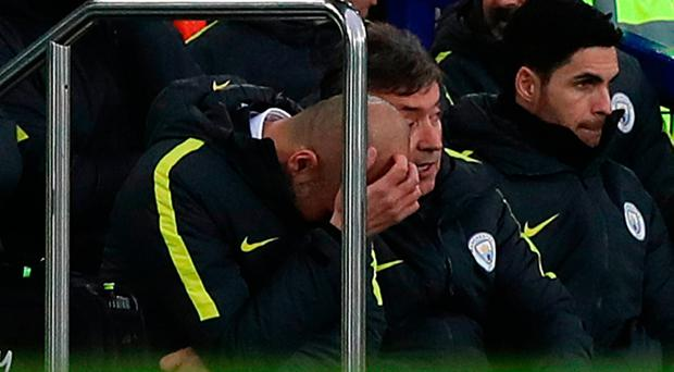 Manchester City manager Pep Guardiola reacts in the dug-out during the defeat against Everton. Photo credit: Peter Byrne/PA Wire