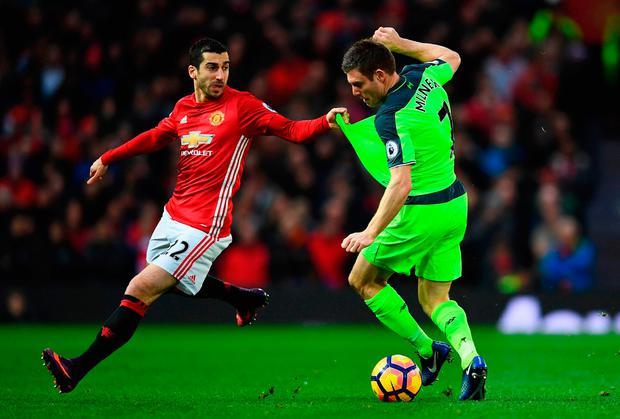 Manchester United's Henrikh Mkhitaryan gets to grips with Liverpool's James Milner. Photo by Laurence Griffiths/Getty Images