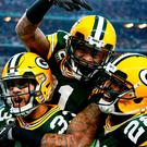 Micah Hyde #33, Ha Ha Clinton-Dix #21, and Josh Hawkins #28 of the Green Bay Packers celebrate in the second half during the NFC Divisional Playoff Game against the Dallas Cowboys at AT&T Stadium on January 15, 2017 in Arlington, Texas.