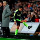 Alexis Sanchez was not happy to be substituted at Swansea CREDIT: PA