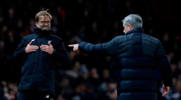 Liverpool manager Jurgen Klopp reacts as Manchester United manager Jose Mourinho looks on. Reuters / Phil Noble