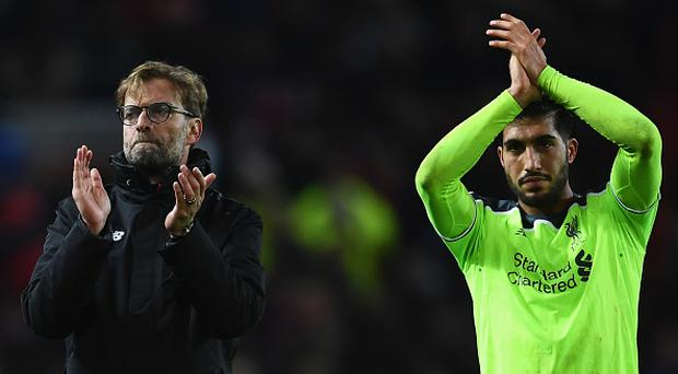 MANCHESTER, ENGLAND - JANUARY 15: Jurgen Klopp manager of Liverpool and Emre Can of Liverpool applaud the travelling fans after the Premier League match between Manchester United and Liverpool at Old Trafford on January 15, 2017 in Manchester, England. (Photo by Laurence Griffiths/Getty Images)