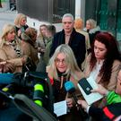 Helena Darcy pictured with family and friends briefing the media on the steps of the Criminal Courts of Justice following the sentencing hearing regarding the investigation into the death of Dale Creighton. Photo: Collins Courts