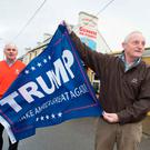 Doonbeg Community Development Chairman John O'Dea and Brendan Walsh from Boston celebrate Donald Trump's victory in Doonbeg, Co Clare, last November. Photo: Eamon Ward