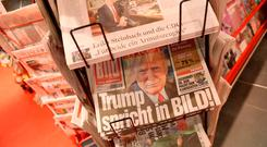 German tabloid Bild Zeitung, featuring an exclusive interview with U.S. President-elect Donald Trump, lies on display at a kiosk in Berlin, Germany. Photo: Sean Gallup/Getty Images