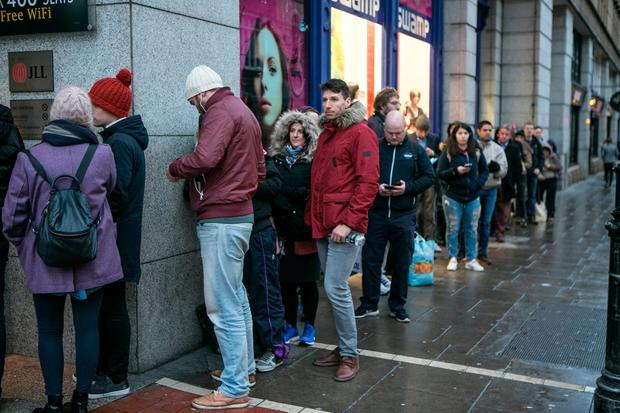 Fans queue up for U2 Tickets at Stephens Green Shopping Center. Photo: Kyran O'Brien