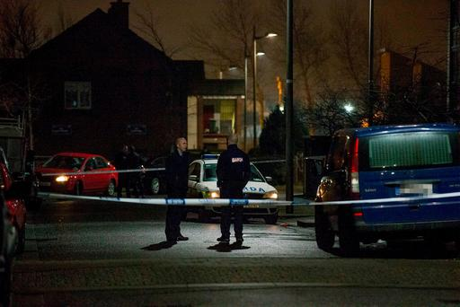 Gardai investigate the shooting of a man near Balbutcher Road in Ballymun in Dublin. Picture: Arthur Carron