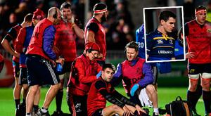 Conor Murray receives treatment and (inset) Sexton