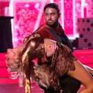 Heavily tanned dancer Hughie Maughan performs with Emily Barker during RTÉ's 'Dancing with the Stars' last Sunday night. Photo: kobpix