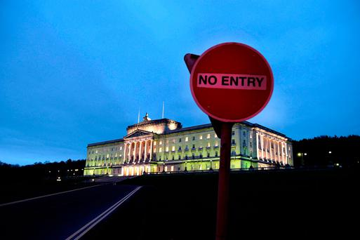 The sun sets over Stormont in Belfast, Northern Ireland. Photo: Charles McQuillan/Getty Images