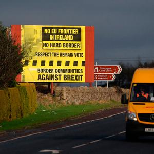 A delivery van passes a Brexit billboard in Jonesborough, Co. Armagh, on the northern side of the border between Northern Ireland and the Republic of Ireland, as Prime Minister Theresa May has said keeping the common travel area between the UK and Republic of Ireland will be a priority in EU divorce talks. Photo: Niall Carson/PA Wire
