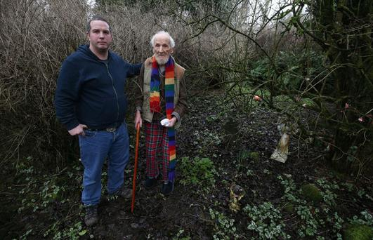 Stephen Sacker, standing by his mother's grave, wants permission to bury his father Hugh there