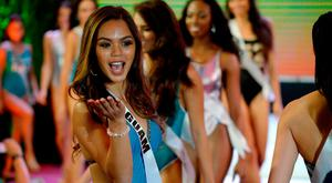 Miss Guam Muneka Joy Cruz Taisipic blows a kiss during a Miss Universe swimwear fashion show in Cebu City, central Philippines