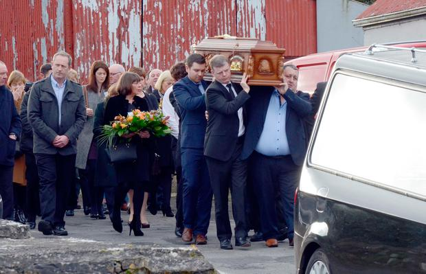 Sinead's coffin being carried by family from Aughagower Church near Westport where the requiem mass was held today