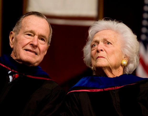 Former President George H.W. Bush (L), and former first lady Barbara Bush attend the Texas A&M University commencement ceremony in College Station. Picture: REUTERS/Larry Downing/File Photo
