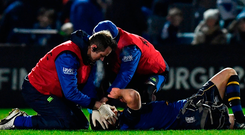 Robbie Henshaw (right) looks on anxiously as Leinster team-mate Johnny Sexton is treated by the medics following Frans Steyn's tackle last Friday SPORTSFILE