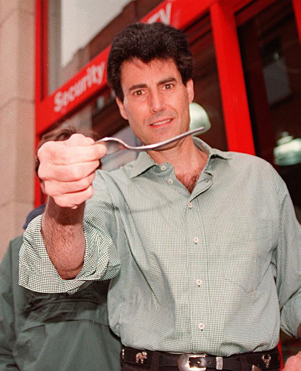 Uri Geller bends a Spoon during his appearance at the new Maplin Electronics Shop on Jervis Street. Photo: Declan Cahill
