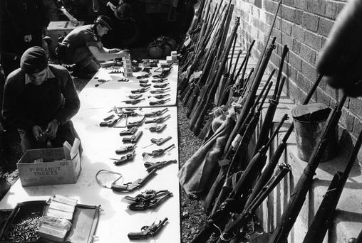 British soldiers sort through a seized weapons cache in Belfast. Photo: Malcolm Stroud/Express/Getty Images