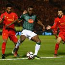 Plymouth Argyle's Jordan Slew in action with Liverpool's Joe Gomez and Kevin Stewart Picture: Reuters