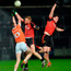 Armagh Ben Crealey tries to claim a mark against Down duo Cathal Magee and Niall Donnelly. Photo: Oliver McVeigh/Sportsfile