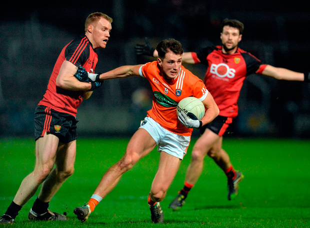 Sean Sheridan of Armagh in action against Cathal Magee of Down. Photo: Oliver McVeigh/Sportsfile