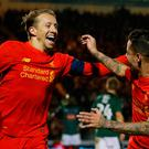 Liverpool's Lucas Leiva celebrates scoring with Philippe Coutinho