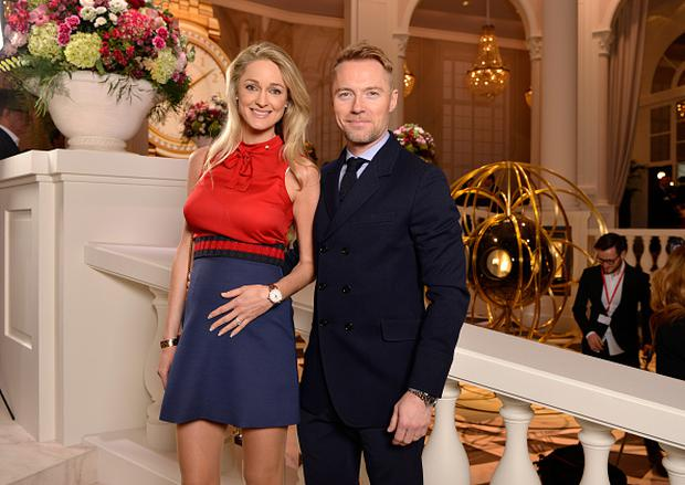 Storm and Ronan Keating visit the IWC booth during the launch of the Da Vinci Novelties from the Swiss luxury watch manufacturer IWC Schaffhausen at the Salon International de la Haute Horlogerie (SIHH) 2017 on January 17, 2017 in Geneva, . (Photo by Harold Cunningham/Getty Images for IWC)