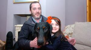 A very happy four-year-old Feiladh Walsh on the return of her two-year-old Doberman Pincer pictured with community warden Alan Nolan: Credit: Seamus Farrelly