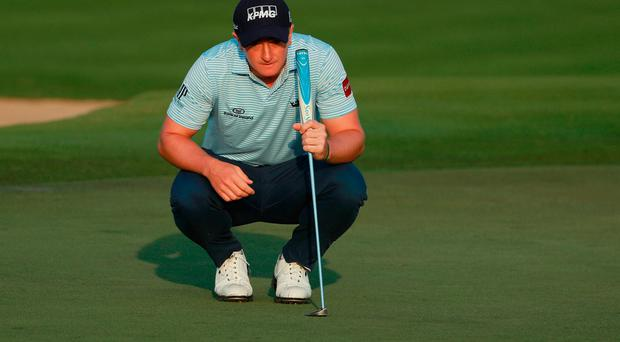 Paul Dunne of Ireland looks over the second green during the first round of the Abu Dhabi HSBC Championship