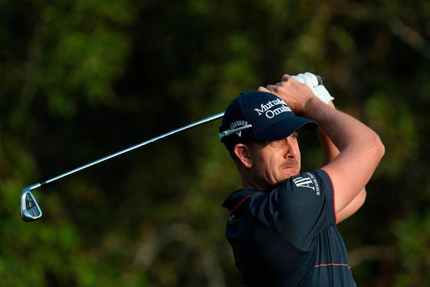Henrik Stenson of Sweden tees off on the 12th hole