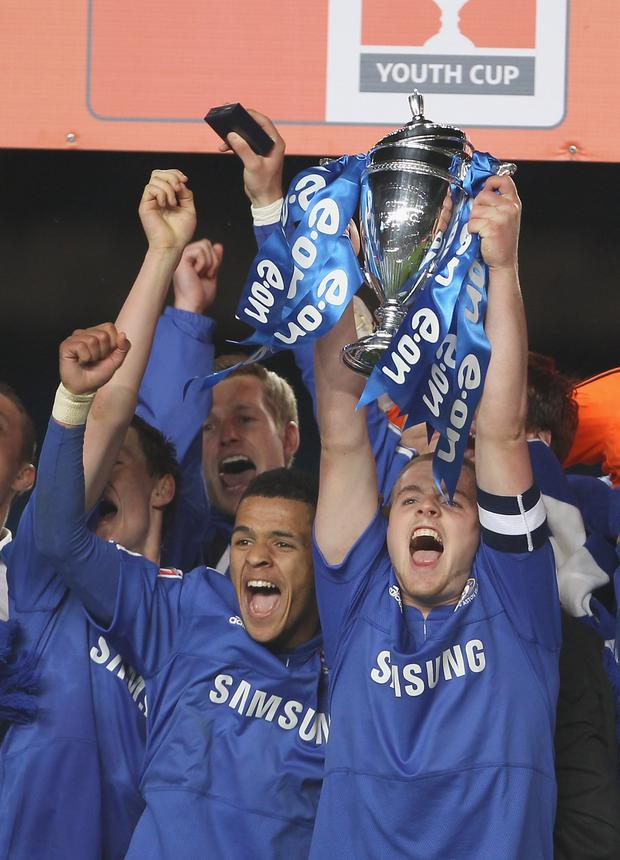 Conor Clifford holds the Trophy aloft after winning the FA Youth Cup Final with Chelsea