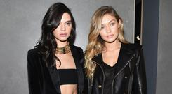 Models Kendall Jenner (L) and Gigi Hadid attend the BALMAIN X H&M Collection Launch at 23 Wall Street on October 20, 2015 in New York City. (Photo by Nicholas Hunt/Getty Images for H&M)