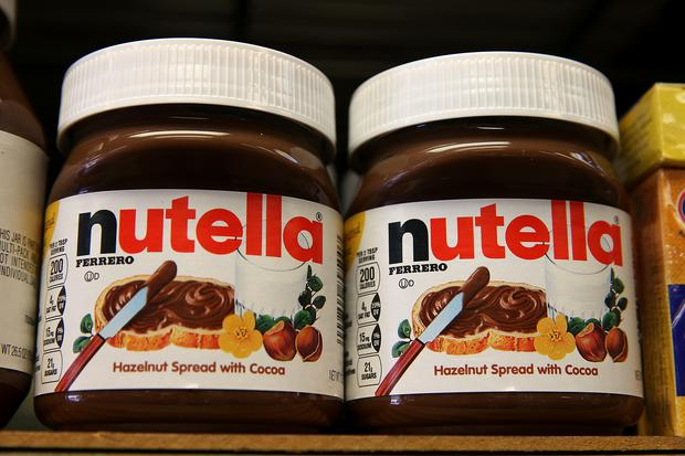 Jars of Nutella are displayed on a shelf at a market