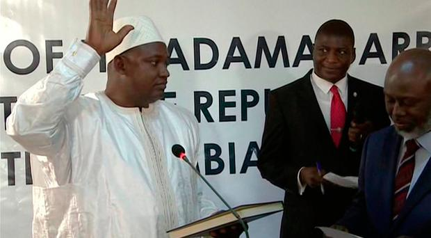 Adama Barrow is sworn in as President of Gambia at Gambia's embassy in Dakar Senegal in this image taken from TV Thursday, Jan 19, 2017. (RTS via AP)