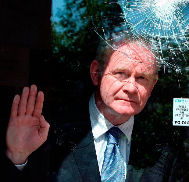 Deputy First Minister Martin McGuinness looking at a smashed window at the City Church in the University area of Belfast. Photo: Paul Faith/PA Wire