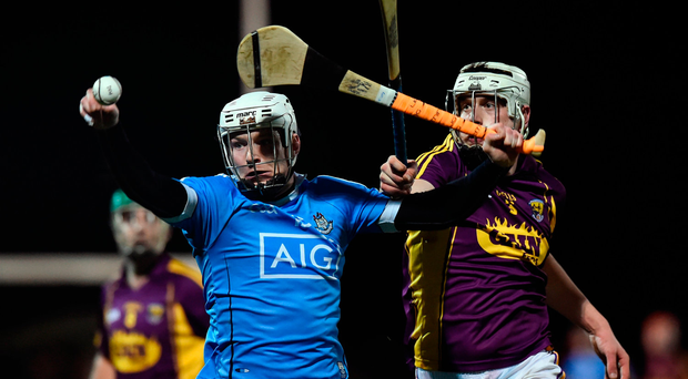 Dublin's Fionntan MacGib beats Wexford's Liam Ryan to the ball in last night's Walsh Cup game in Hollymount, Wexford. Photo: Matt Browne/Sportsfile