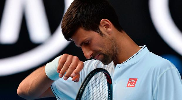 Novak Djokovic all alone with his thoughts in Melbourne. Photo: Getty Images