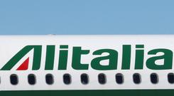 An Alitalia plane prepares to take off from Linate Airport, Milan, Italy