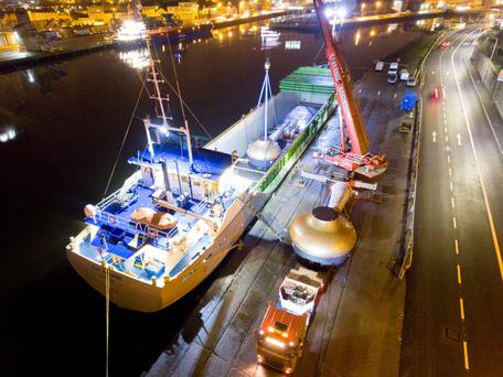 The three new copper pot stills being unloaded in Cork Harbour