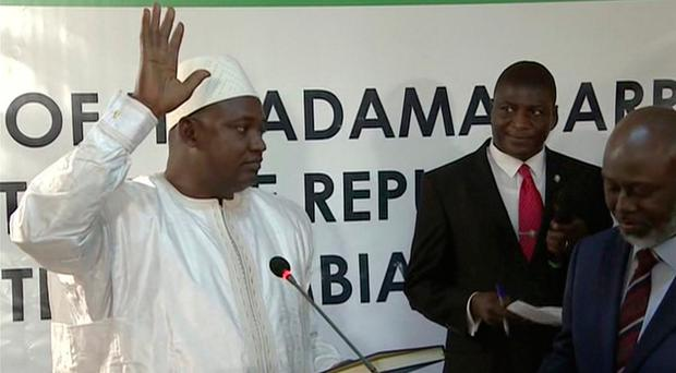 Adama Barrow is sworn in as President of Gambia at Gambia's embassy in Dakar Senegal in this image taken from TV. Photo: RTS via AP