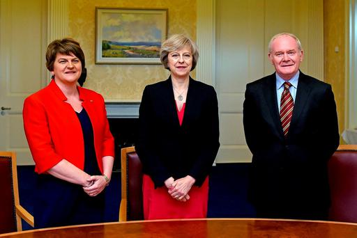 British Prime Minister Theresa May with Arlene Foster and Martin McGuinness at Stormont Castle in Belfast last July Photo: Reuters