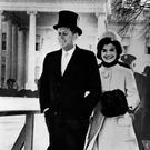 Walking arm in arm, President John F, Kennedy and his wife Jacqueline on their way to the reviewing stand to watch the inauguration parade (Photo by Popperfoto/Getty Images)