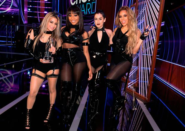(L-R) Recording artists Ally Brooke, Normani Kordei, Lauren Jauregui, and Dinah Jane of music group Fifth Harmony, winners of the Favorite Group award, pose onstage during the People's Choice Awards 2017 at Microsoft Theater on January 18, 2017 in Los Angeles, California. (Photo by Christopher Polk/Getty Images for People's Choice Awards)