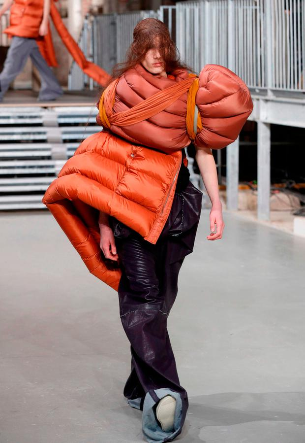 A model presents a creation by US fashion designer Rick Owens, during men's Fashion Week for the Fall/Winter 2017/2018 collection in Paris