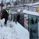 A still image taken from a video shows firefighters working at Hotel Rigopiano in Farindola, central Italy, after it was hit by an avalanche, January 20, 2017 provided by Italy's Fire Fighters.