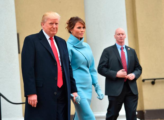 Melania trump opts for sky blue ralph lauren dress for inauguration us president elect and his wife melania leave st johns episcopal church on january m4hsunfo