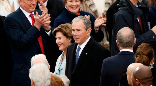 George and Laura Bush attend the inauguration ceremonies to swear in Donald Trump as the 45th president of the United States at the U.S. Capitol in Washington, U.S., January 20, 2017. REUTERS/Kevin Lamarque