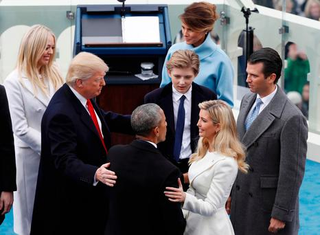 Former U.S. President Barack Obama speaks with Ivanka Trump and other members of the family of U.S. President Donald Trump during inauguration ceremonies swearing in Trump as the 45th president of the United States on the West front of the U.S. Capitol in Washington, U.S., January 20, 2017. REUTERS/Brian Snyder