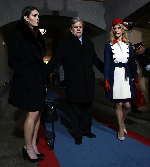 (L-R) Donald Trump's White House Director of Strategic Communications Hope Hicks, Senior Counselor Steve Bannon and Counselor to the President Kellyanne Conway arrive for the presidential inauguration on the West Front of the US Capitol on January 20, 2017 in Washington, DC. (Photo credit should read WIN MCNAMEE/AFP/Getty Images)